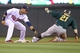 Sep 10, 2013; Minneapolis, MN, USA; Minnesota Twins shortstop Pedro Florimon (25) tags out Oakland Athletics catcher Stephen Vogt (21) attempting to steal second base during the fifth inning at Target Field. Mandatory Credit: Brace Hemmelgarn-USA TODAY Sports