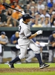 Sep 10, 2013; Baltimore, MD, USA; New York Yankees third baseman Alex Rodriguez (13) doubles in the eighth inning against the Baltimore Orioles at Oriole Park at Camden Yards. The Yankees won 7-5. Mandatory Credit: Joy R. Absalon-USA TODAY Sports