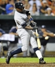 Sep 10, 2013; Baltimore, MD, USA; NNew York Yankees left fielder Alfonso Soriano (12) hits the go-ahead two run home run in the eighth inning against the Baltimore Orioles at Oriole Park at Camden Yards. The Yankees won 7-5. Mandatory Credit: Joy R. Absalon-USA TODAY Sports