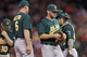 Sep 10, 2013; Minneapolis, MN, USA; Oakland Athletics pitcher Ryan Cook (48) is removed from the game by manager Bob Melvin (6) during the eighth inning against the Minnesota Twins at Target Field. The Twins won 4-3. Mandatory Credit: Brace Hemmelgarn-USA TODAY Sports