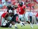 Sep 7, 2013; Oxford, MS, USA; Mississippi Rebels defensive end Robert Nkemdiche (5) sets up for a tackle during the game against the Southeast Missouri State Redhawks at Vaught-Hemingway Stadium. Mississippi Rebels defeated the Southeast Missouri State Redhawks 31-13.  Mandatory Credit: Spruce Derden-USA TODAY Sports