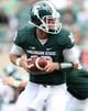 Sep 7, 2013; East Lansing, MI, USA; Michigan State Spartans quarterback Andrew Maxwell (10) attempts to hand the ball off during the 2nd half at Spartan Stadium. MSU won 21-6. Mandatory Credit: Mike Carter-USA TODAY Sports