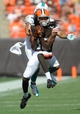 Sep 8, 2013; Cleveland, OH, USA; Cleveland Browns wide receiver Travis Benjamin (80) makes a catch ahead of the defense of Miami Dolphins safety Jimmy Wilson (27) during the fourth quarter at FirstEnergy Stadium. Mandatory Credit: Ken Blaze-USA TODAY Sports