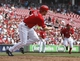Sep 11, 2013; Cincinnati, OH, USA;Cincinnati Reds shortstop Zack Cozart grounds out to score a run in the second inning against the Chicago Cubs at Great American Ball Park. Mandatory Credit: David Kohl-USA TODAY Sports