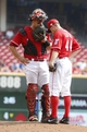 Sep 11, 2013; Cincinnati, OH, USA; Cincinnati Reds catcher Devin Mesoraco, left, talks at the mound with Cincinnati Reds starting pitcher Mike Leake during a game against the Chicago Cubs at Great American Ball Park. Mandatory Credit: David Kohl-USA TODAY Sports