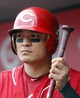 Sep 11, 2013; Cincinnati, OH, USA; Cincinnati Reds center fielder Shin-Soo Choo gets ready to bat in the dugout during a game against the Chicago Cubs at Great American Ball Park. Mandatory Credit: David Kohl-USA TODAY Sports
