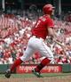 Sep 11, 2013; Cincinnati, OH, USA; Cincinnati Reds third baseman Jack Hannahan (9) watches his three-run home run against the Chicago Cubs in the sixth inning at Great American Ball Park. Mandatory Credit: David Kohl-USA TODAY Sports
