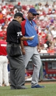 Sep 11, 2013; Cincinnati, OH, USA; Chicago Cubs manager Dale Sveum, right, talks with home plate umpire Alfonso Marquez (left) during a pitcher change in a game against the Cincinnati Reds at Great American Ball Park. Mandatory Credit: David Kohl-USA TODAY Sports