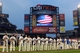 Sep 11, 2013; New York, NY, USA; New York Mets players and coaches observe a moment of silence in remembrance of the attacks on September 11, 2001 before a game against the Washington Nationals at Citi Field. Mandatory Credit: Brad Penner-USA TODAY Sports