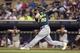 Sep 11, 2013; Minneapolis, MN, USA; Oakland Athletics third baseman Josh Donaldson (20) hits a RBI single in the fourth inning against the Minnesota Twins at Target Field. Mandatory Credit: Jesse Johnson-USA TODAY Sports