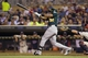 Sep 11, 2013; Minneapolis, MN, USA; Oakland Athletics left fielder Yoenis Cespedes (52) hits a two run double in the fourth inning against the Minnesota Twins at Target Field. Mandatory Credit: Jesse Johnson-USA TODAY Sports