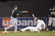 Sep 11, 2013; Minneapolis, MN, USA; Oakland Athletics shortstop Jed Lowrie (8) forces out Minnesota Twins left fielder Josh Willingham (16) at second base and throws the ball to first base for a double play in the fourth inning at Target Field. Mandatory Credit: Jesse Johnson-USA TODAY Sports