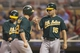Sep 11, 2013; Minneapolis, MN, USA; Oakland Athletics catcher Stephen Vogt (21) celebrates with designated hitter Seth Smith (15) after hitting a home run in the fourth inning against the Minnesota Twins at Target Field. Mandatory Credit: Jesse Johnson-USA TODAY Sports