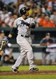 Sep 11, 2013; Baltimore, MD, USA; New York Yankees second baseman Robinson Cano (24) hits the go-ahead solo home run in the ninth inning against the Baltimore Orioles at Oriole Park at Camden Yards. The Yankees defeated the Orioles 5-4. Mandatory Credit: Joy R. Absalon-USA TODAY Sports