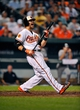 Sep 11, 2013; Baltimore, MD, USA; Baltimore Orioles first baseman Chris Davis (19) reacts after striking out in the eighth inning against the New York Yankees at Oriole Park at Camden Yards. The Yankees defeated the Orioles 5-4. Mandatory Credit: Joy R. Absalon-USA TODAY Sports