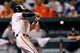 Sep 11, 2013; Baltimore, MD, USA; Baltimore Orioles second baseman Brian Roberts (1) hits a one-run single in the ninth inning against the New York Yankees at Oriole Park at Camden Yards. The Yankees defeated the Orioles 5-4. Mandatory Credit: Joy R. Absalon-USA TODAY Sports
