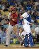 Sep 11, 2013; Los Angeles, CA, USA; Arizona Diamondbacks right fielder Gerardo Parra (8) crosses home plate to score in the second inning as Los Angeles Dodgers catcher A.J. Ellis (17) watches at Dodger Stadium. Mandatory Credit: Kirby Lee-USA TODAY Sports