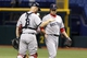 Sep 11, 2013; St. Petersburg, FL, USA; Boston Red Sox relief pitcher Junichi Tazawa (36) and catcher David Ross (3) congratulate each other after they beat the Tampa Bay Rays at Tropicana Field. Boston Red Sox defeated the Tampa Bay Rays 7-3. Mandatory Credit: Kim Klement-USA TODAY Sports