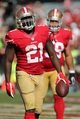 Sep 8, 2013; San Francisco, CA, USA; San Francisco 49ers running back Frank Gore (21) after a touchdown against the Green Bay Packers during the fourth quarter at Candlestick Park. The San Francisco 49ers defeated the Green Bay Packers 34-28. Mandatory Credit: Kelley L Cox-USA TODAY Sports