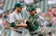 Sep 12, 2013; Minneapolis, MN, USA; Oakland Athletics pitcher Dan Otero (61) and catcher Derek Norris (36) talk on the mound in the eighth inning against the Minnesota Twins at Target Field. Mandatory Credit: Brad Rempel-USA TODAY Sports