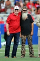 Sep 12, 2013; Ruston, LA, USA; NFL former quarterback Terry Bradshaw (left) and television personality Phil Robertson are honored during a ceremony at Joe Aillet Stadium during a break in the game between the Louisiana Tech Bulldogs and the Tulane Green Wave. Both men played quarterback for Louisiana Tech. Mandatory Credit: Chuck Cook-USA TODAY Sports