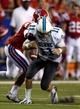 Sep 12, 2013; Ruston, LA, USA; Tulane Green Wave quarterback Nick Montana (11) fumbles after being hit by Louisiana Tech Bulldogs linebacker Daniel Cobb (47) in the second quarter at Joe Aillet Stadium. Mandatory Credit: Chuck Cook-USA TODAY Sports