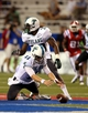 Sep 12, 2013; Ruston, LA, USA; Tulane Green Wave quarterback Nick Montana (11) falls on the football after a fumbled snap against the Louisiana Tech Bulldogs in the second quarter at Joe Aillet Stadium. Mandatory Credit: Chuck Cook-USA TODAY Sports