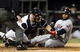 Sep 12, 2013; Chicago, IL, USA; Chicago White Sox catcher Josh Phegley (left) tags out Cleveland Indians designated hitter Carlos Santana (right) during the fourth inning at U.S Cellular Field. Mandatory Credit: Jerry Lai-USA TODAY Sports
