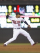 Sep 13, 2013; Minneapolis, MN, USA; Minnesota Twins shortstop Eduardo Escobar (5) throws the ball to first base in the second inning against the Tampa Bay Rays at Target Field. Mandatory Credit: Jesse Johnson-USA TODAY Sports