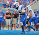 Sep 13, 2013; Boise, ID, USA; Air Force Falcons quarterback Jaleel Awini (12) runs the ball during the first half against the Boise State Broncos at Bronco Stadium. Mandatory Credit: Brian Losness-USA TODAY Sports