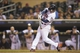Sep 13, 2013; Minneapolis, MN, USA; Minnesota Twins shortstop Eduardo Escobar (5) hits a single in the eighth inning against the Tampa Bay Rays at Target Field. The Rays won 3-0. Mandatory Credit: Jesse Johnson-USA TODAY Sports