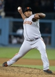 Sep 13, 2013; Los Angeles, CA, USA; San Francisco Giants reliever Jean Machi delivers a pitch against the Los Angeles Dodgers at Dodger Stadium. The Giants defeated the Dodgers 4-2. Mandatory Credit: Kirby Lee-USA TODAY Sports