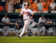 Sep 11, 2013; Baltimore, MD, USA; Baltimore Orioles left fielder Nate McLouth (9) heads to home plate in the ninth inning against the New York Yankees at Oriole Park at Camden Yards. The Yankees defeated the Orioles 5-4. Mandatory Credit: Joy R. Absalon-USA TODAY Sports