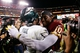Sep 9, 2013; Landover, MD, USA; Philadelphia Eagles quarterback Michael Vick (7) and and Washington Redskins quarterback Robert Griffin III (10) hug after their game at FedEx Field. Mandatory Credit: Geoff Burke-USA TODAY Sports