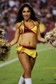 Sep 9, 2013; Landover, MD, USA; A Washington Redskins cheerleader dances on the field against the Philadelphia Eagles at FedEx Field. Mandatory Credit: Geoff Burke-USA TODAY Sports