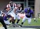 Sep 14, 2013; Greenville, NC, USA; Virginia Tech Hokies quarterback Logan Thomas (3) runs as he is tackled by East Carolina Pirates defensive end Johnathon White (94) during the first half at Dowdy-Ficklen Stadium. Mandatory Credit: Rob Kinnan-USA TODAY Sports