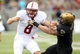 Sep 14, 2013; West Point, NY, USA; Stanford Cardinal quarterback Kevin Hogan (8) fumbles the ball as he's dragged down by Army Black Knights linebacker Dalton Mendenhall (7) during the first half at Michie Stadium. Mandatory Credit: Danny Wild-USA TODAY Sports
