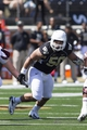 Sep 14, 2013; Winston-Salem, NC, USA; Wake Forest Demon Deacons nose tackle Nikita Whitlock (50) pursues the ball carrier during the second quarter against the Louisiana Monroe Warhawks at BB&T Field. Mandatory Credit: Jeremy Brevard-USA TODAY Sports