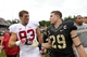 Sep 14, 2013; West Point, NY, USA; Stanford Cardinal tight end Davis Dudchock (83) greets Army Black Knights linebacker and captain Thomas Holloway (29) after Stanford beat Army 34-20 at Michie Stadium. Mandatory Credit: Danny Wild-USA TODAY Sports