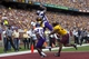 Sep 14, 2013; Minneapolis, MN, USA; Western Illinois Leathernecks wide receiver Lance Lenoir Jr. (7) catches a touchdown over Minnesota Golden Gophers defensive back Derrick Wells (13) in the third quarter at TCF Bank Stadium. The Gophers won 29-12. Mandatory Credit: Jesse Johnson-USA TODAY Sports
