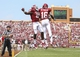 Sep 14, 2013; Norman, OK, USA; Oklahoma Sooners running back Keith Ford (21) celebrates scoring a touchdown with wide receiver Jaz Reynolds (16) during the game at Gaylord Family - Oklahoma Memorial Stadium. Mandatory Credit: Kevin Jairaj-USA TODAY Sports