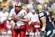Sep 14, 2013; Pittsburgh, PA, USA; New Mexico Lobos quarterback Cole Gautsche (8) scrambles with the ball against the Pittsburgh Panthers during the third quarter at Heinz Field. The Pittsburgh Panthers won 49-27. Mandatory Credit: Charles LeClaire-USA TODAY Sports