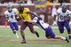 Sep 14, 2013; Minneapolis, MN, USA; Minnesota Golden Gophers wide receiver K.J. Maye (1) runs a punt back past Western Illinois Leathernecks kicker Nathan Knuffman (33) in the fourth quarter at TCF Bank Stadium. The Gophers won 29-12. Mandatory Credit: Jesse Johnson-USA TODAY Sports