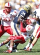 Sep 14, 2013; Pittsburgh, PA, USA; Pittsburgh Panthers running back Isaac Bennett (34) carries the ball past New Mexico Lobos defensive back Brandon Branch (36) during the fourth quarter at Heinz Field. The Pittsburgh Panthers won 49-27. Mandatory Credit: Charles LeClaire-USA TODAY Sports