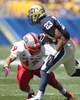 Sep 14, 2013; Pittsburgh, PA, USA; Pittsburgh Panthers wide receiver Tyler Boyd (23) returns a kick-off as New Mexico Lobos linebacker Dakota Cox (49) defends during the third quarter at Heinz Field. The Pittsburgh Panthers won 49-27. Mandatory Credit: Charles LeClaire-USA TODAY Sports