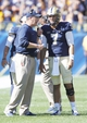 Sep 14, 2013; Pittsburgh, PA, USA; Pittsburgh Panthers head coach Paul Chryst (left) talks with quarterback Tom Savage (7) during a time-out against the New Mexico Lobos during the fourth quarter at Heinz Field. The Pittsburgh Panthers won 49-27. Mandatory Credit: Charles LeClaire-USA TODAY Sports