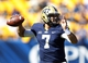 Sep 14, 2013; Pittsburgh, PA, USA; Pittsburgh Panthers quarterback Tom Savage (7) passes the ball against the New Mexico Lobos during the fourth quarter at Heinz Field. The Pittsburgh Panthers won 49-27.  Mandatory Credit: Charles LeClaire-USA TODAY Sports