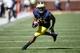 Sep 14, 2013; Ann Arbor, MI, USA; Michigan Wolverines wide receiver Jeremy Gallon (21) runs the ball in the fourth quarter against the Akron Zips at Michigan Stadium. Michigan won 28-24. Mandatory Credit: Rick Osentoski-USA TODAY Sports