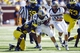 Sep 14, 2013; Ann Arbor, MI, USA; Akron Zips running back Conor Hundley (34) is hit by Michigan Wolverines safety Jarrod Wilson (22) in the fourth quarter at Michigan Stadium. Michigan won 28-24. Mandatory Credit: Rick Osentoski-USA TODAY Sports