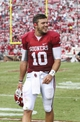 Sep 14, 2013; Norman, OK, USA; Oklahoma Sooners quarterback Blake Bell (10) reacts after the victory against the Tulsa Golden Hurricane at Gaylord Family - Oklahoma Memorial Stadium. Mandatory Credit: Kevin Jairaj-USA TODAY Sports